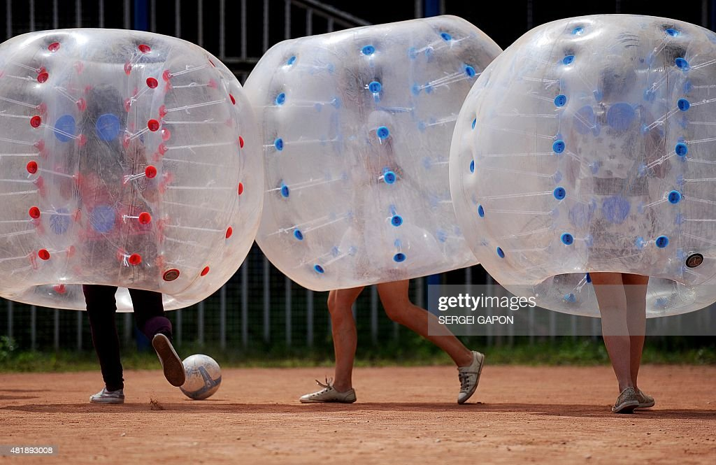 S In Inflatable Play Bubble Football During The Freaky Summer Party At A Park
