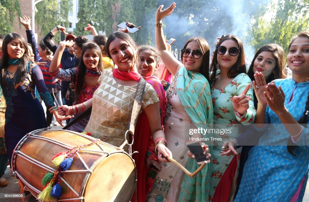Girls in jubilant mood during Lohri celebration in Guru Gobind Singh Khalsa College for Women at sector 26, on January 13, 2018 in Chandigarh, India. Lohri is a great occasion that holds great importance for farmers. The festival of harvest, Lohri is being celebrated in North India especially in Punjab, Haryana, Himachal Pradesh and Delhi. Popcorns, peanuts, Rewari and Gajak are distributed to all neighbours, friends and relatives on the occasion.