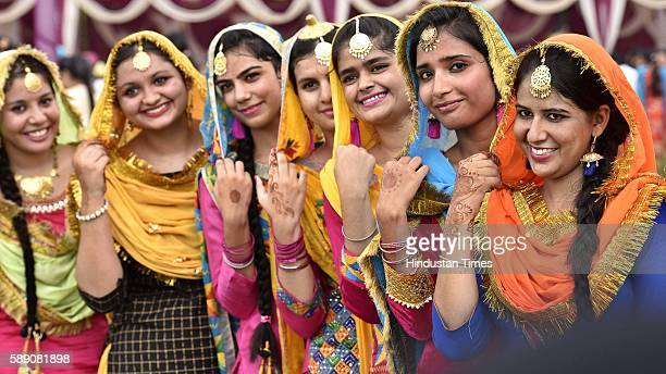 Girls in jubilant mood during the Teej festival celebration organized at Khalsa Collage on August 13 2016 in Amritsar India The festival is...