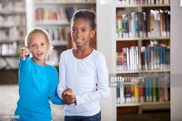 Girls in library