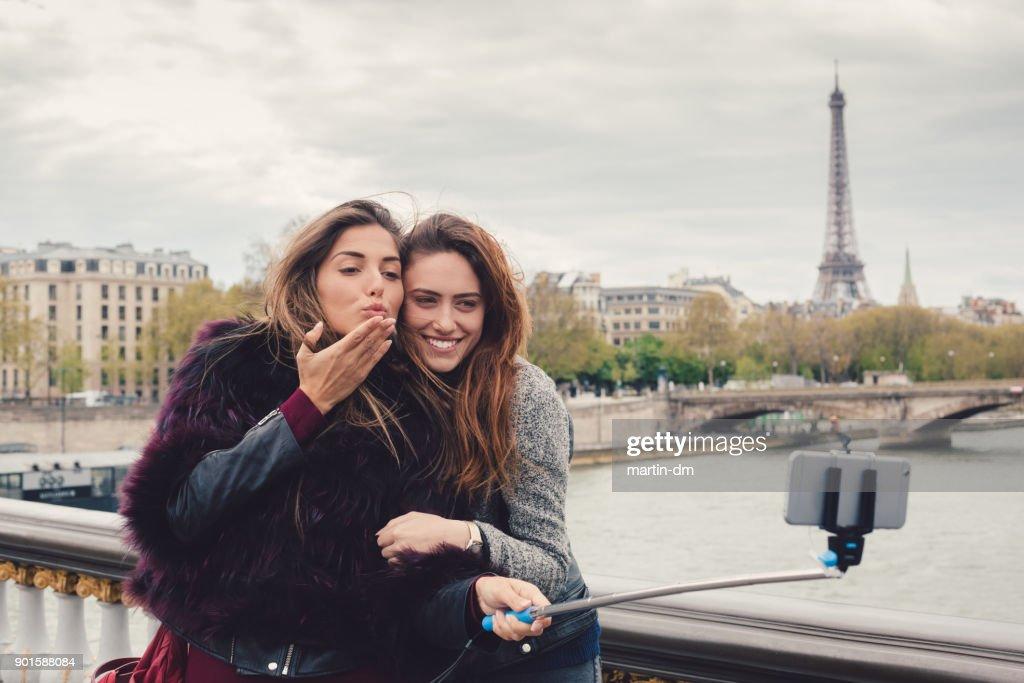 Happy girls taking selfie in Paris