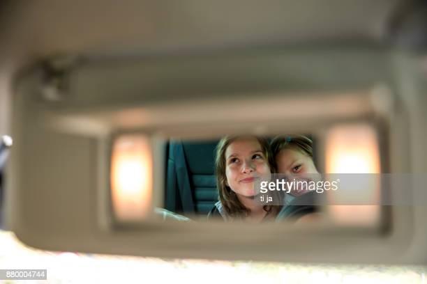 Girls in rear-view mirror