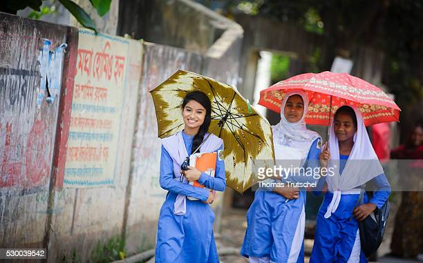 Girls in school uniform walking along a road after school on April 13 2016 in Savar Bangladesh