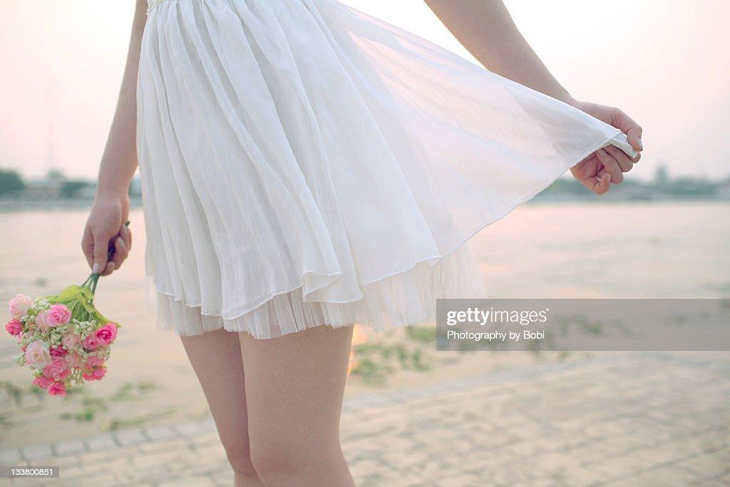 Girls in short skirts beside river : Stock Photo