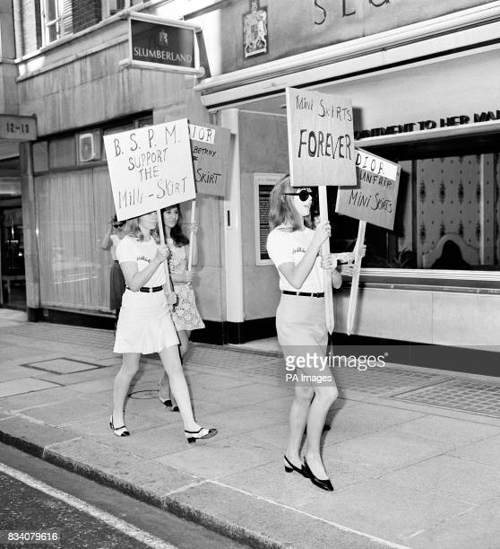 Girls in shortskirts parade the streets of London holding placards in support of the miniskirt
