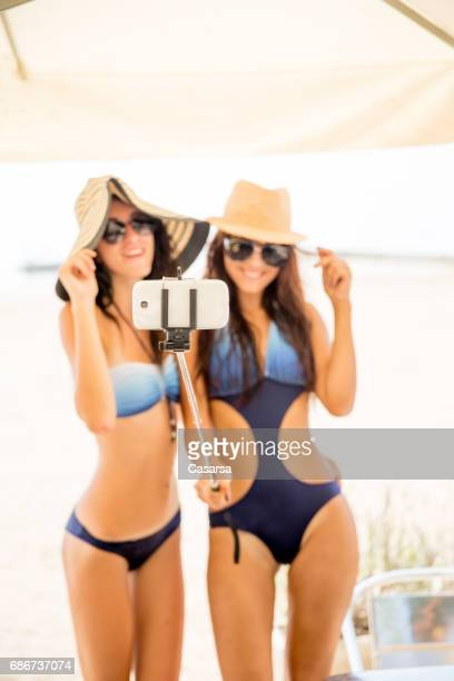 girls in swimwear taking a selfie - hot body girls stock photos and pictures