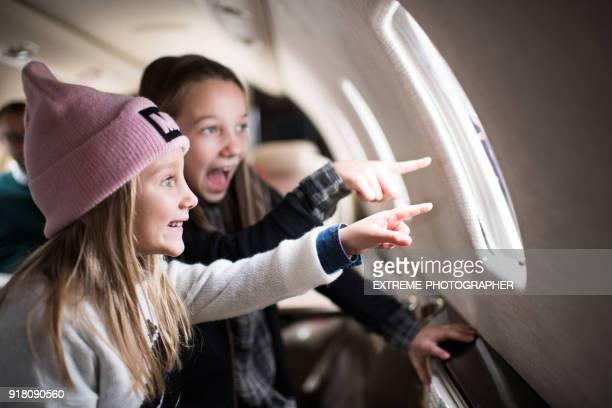 girls in the airplane - reportaje imágenes stock pictures, royalty-free photos & images