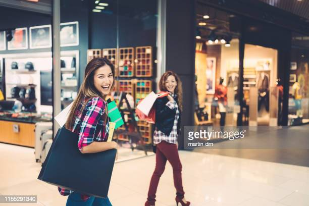 girls in the shopping mall - black friday stock photos and pictures
