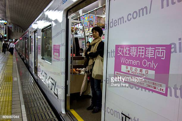 Girls in the 'Women Only' carriage in a Osaka Municipal Subway