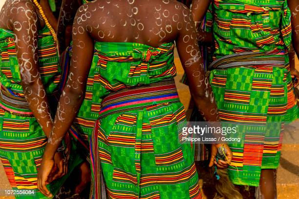 girls in traditional costume attending mass in radio maria in cristo risorto de hedzranawoe catholic parish church, lome, togo. - togo stock pictures, royalty-free photos & images