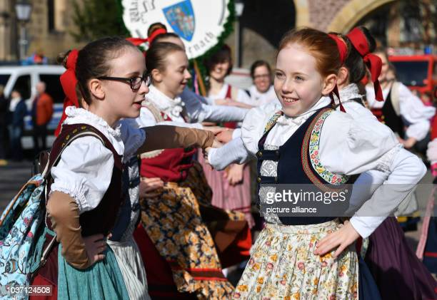 Girls in traditional costume during the traditional spring festival parade in Eisenach Germany 25 March 2017 This year's theme is '500 years of...