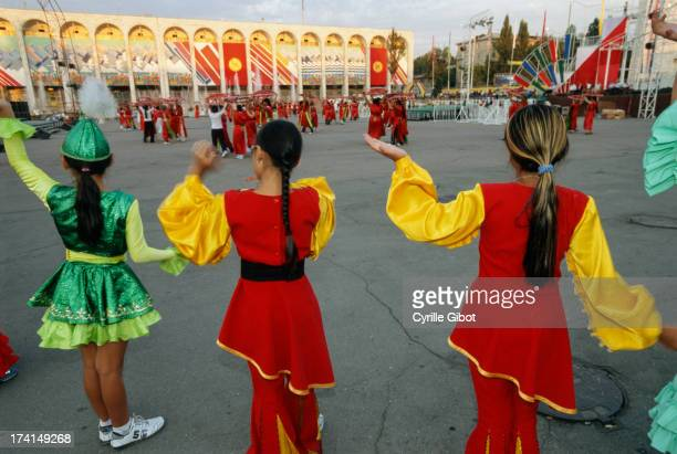 CONTENT] Girls in traditional costumes rehearsing dance for Victory Day