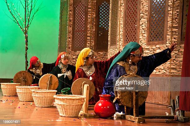 Girls in traditional Kashmiri attire perform during JashneChillai Kalaan organized by Funtoosh on January 5 2013 in Srinagar the summer capital of...