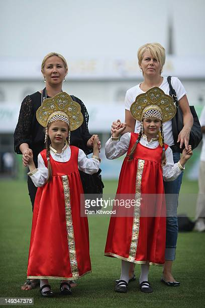 Girls in traditional Russian dress stand with their parents during a sound check at Sochi Park on July 27 2012 in London England The Russia...