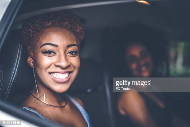 girls inside a car - friends inside car stock photos and pictures