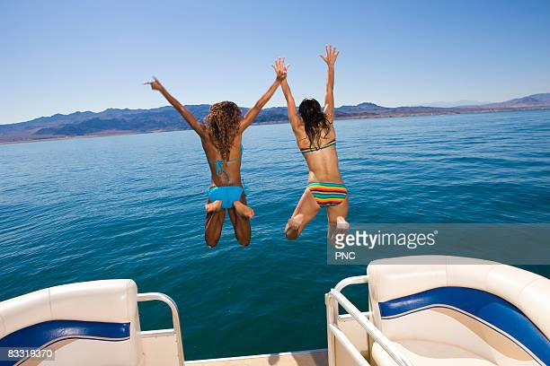 Girls jump off boat
