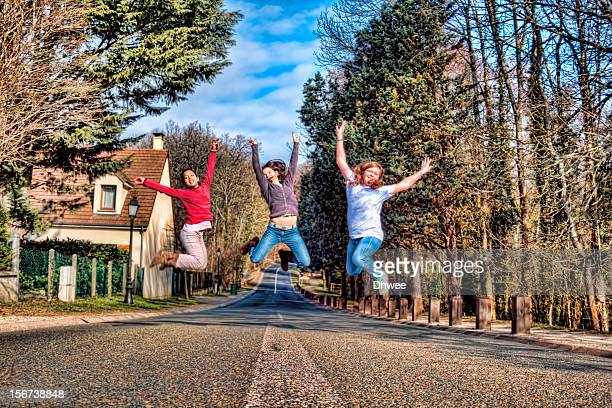 girls jump on the street in a beautiful day - only girls stock pictures, royalty-free photos & images