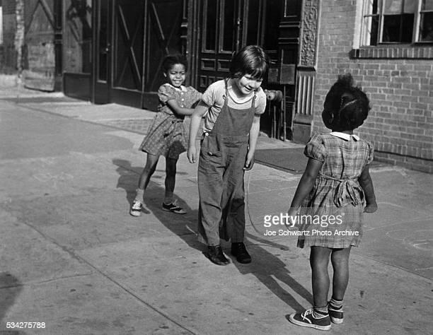 Girls Jump Rope on Sidewalk in Brooklyn