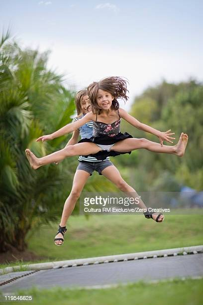 Girls jumping on trampoline together