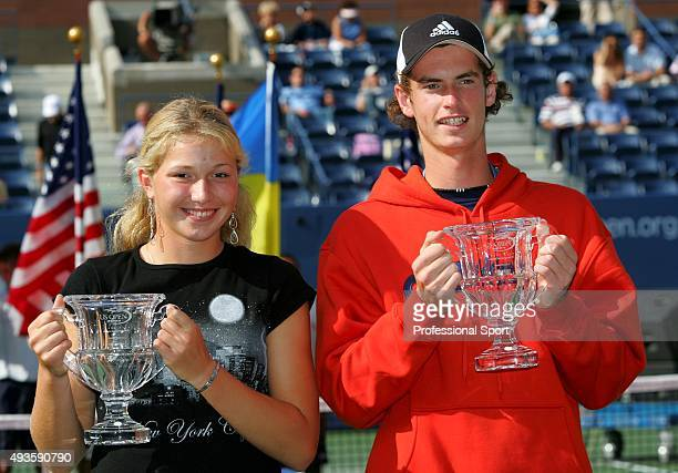 Girl's Junior winner Michaella Krajicek of the Netherlands and the Boy's junior winner Andy Murray pose with their trophies during the US Open...