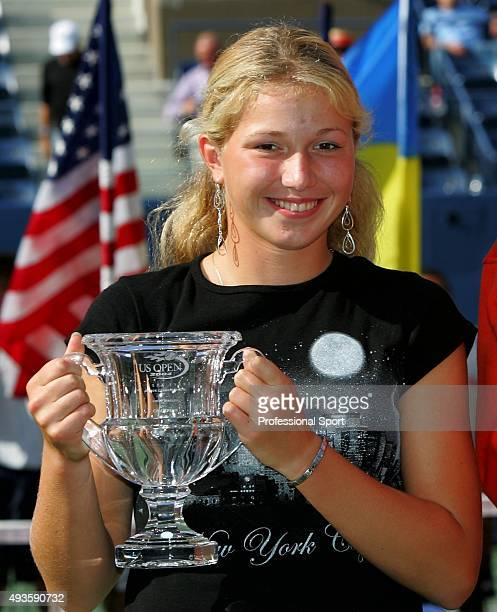 Girl's Junior winner Michaella Krajicek of the Netherlands poses with her trophy after defeating Jessica Kirkland during the US Open September 12...
