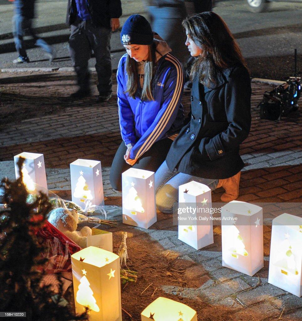 Girls Kneel During Candle Light Vigil Following Shooting