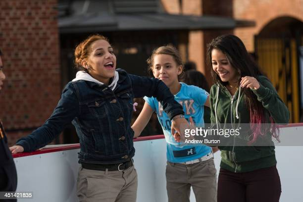 Girls laugh while ice skating at the ice rink at McCarren Pool which opened for the winter months last week on November 22 2013 in the Green Point...