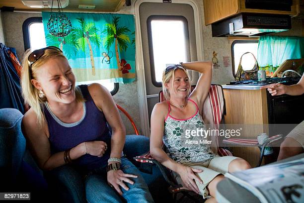 Girls laughing in back of RV.