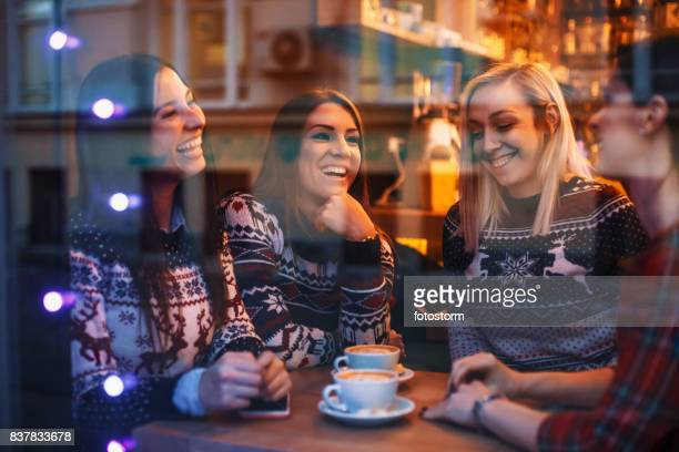 Girls laughing in cafe