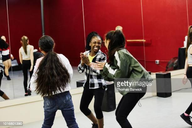 girls laughing together during hip hop dance class in dance studio - dance troupe bildbanksfoton och bilder