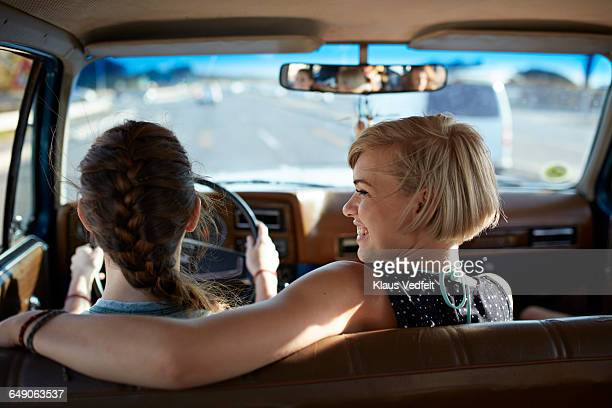 Girls lauging together while driving car