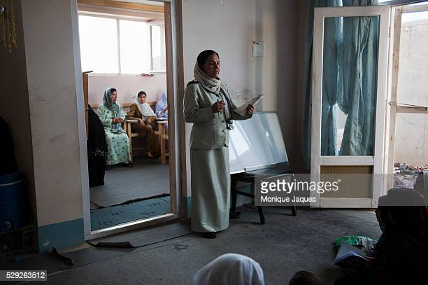 Girls learn to read and write at a Pashtun vocational school in Kabul Afghanistan The school is run as a vocational school billed as a place for...