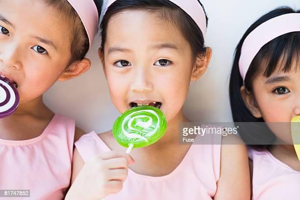 Girls Licking Lollipops
