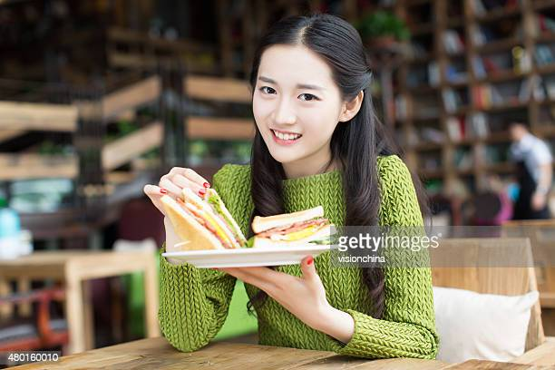 girls like to eat sandwiches