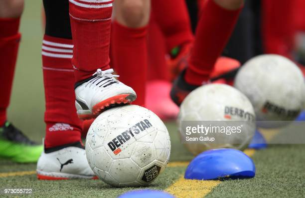 Girls line up with soccer balls while participating in a training day in a program to encourage integration of children with foreign roots through...