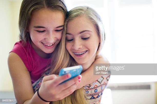 Girls listening to music laughing.