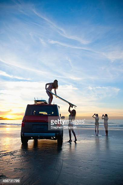 girls loading car, end of the day at the beach