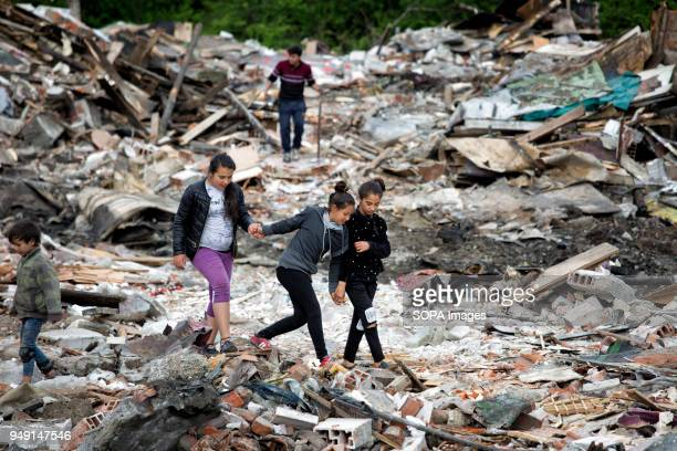 Girls look for items of value in the debris after homes were razed in a Roma quarter of Sofia At least 20 homes deemed illegal were destroyed by the...
