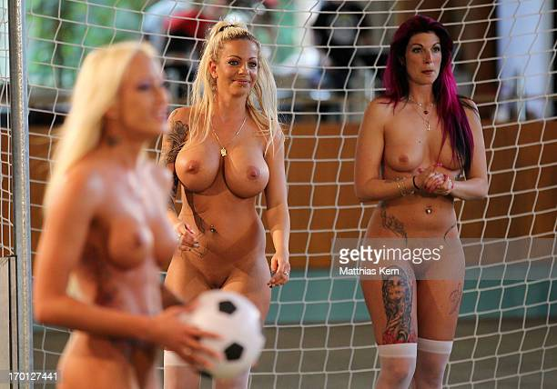 Girls look on during the first women's naked soccer European Championship at 'Palais am Funkturm' on June 7 2013 in Berlin Germany