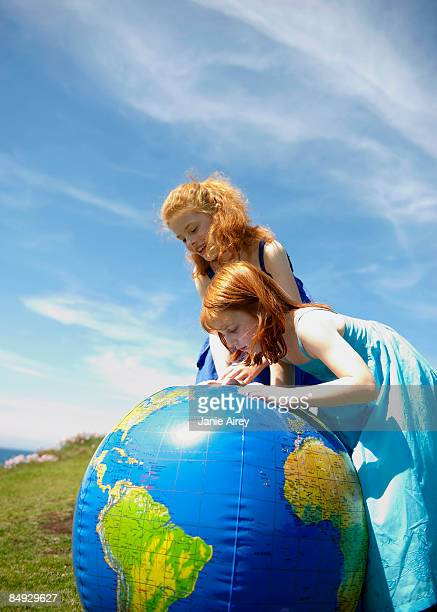 2 girls looking at inflatable globe