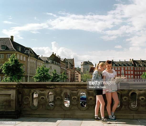 Girls looking at map in Copenhagen