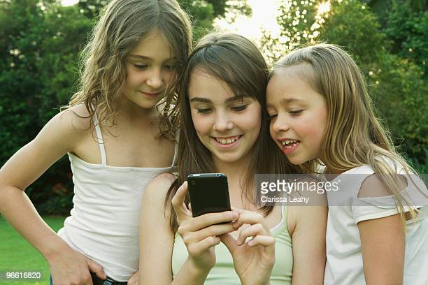 Girl's looking at photo on phone