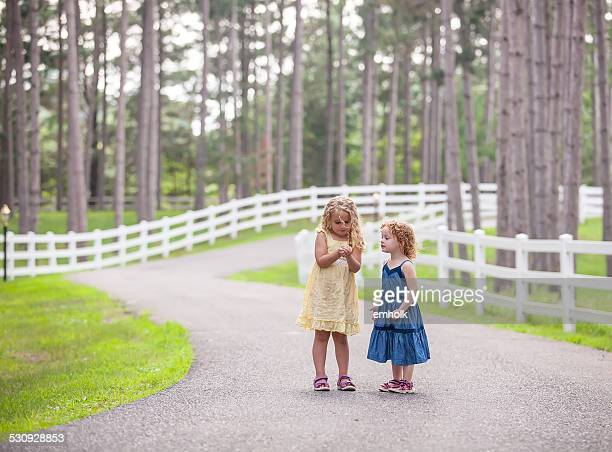 girls looking at something in hand - blue dress stock pictures, royalty-free photos & images