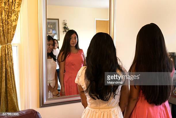 women looking at themselves