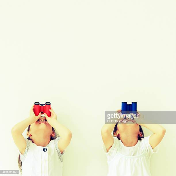 Girls Looking Through Binoculars