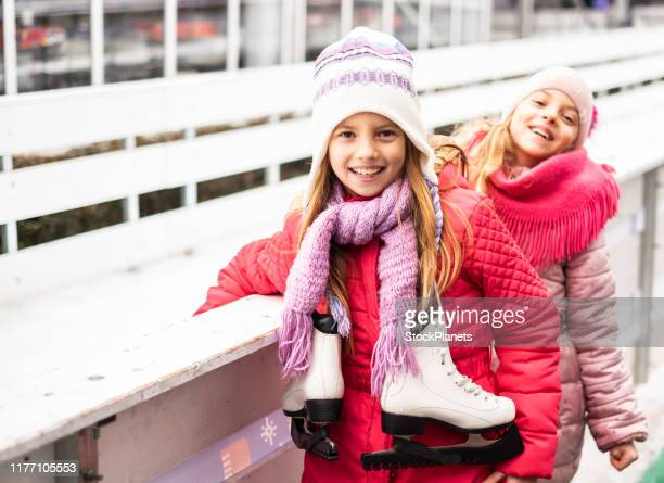 girls love winter sports - ice skate stock pictures, royalty-free photos & images