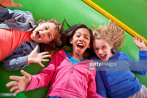 girls lying down in bounce house - only girls stock pictures, royalty-free photos & images
