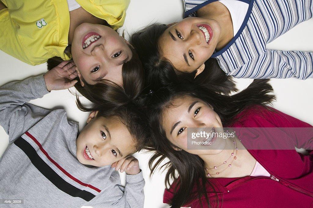Girls lying on their back smiling : Foto de stock