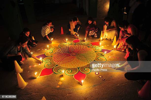 Girls make rangoli on the occasion of Diwali festival in Allahabad