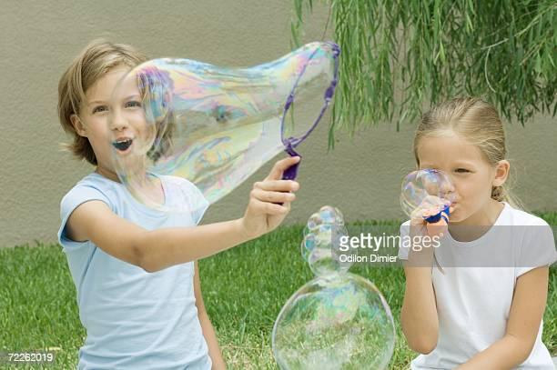 Girls making bubbles
